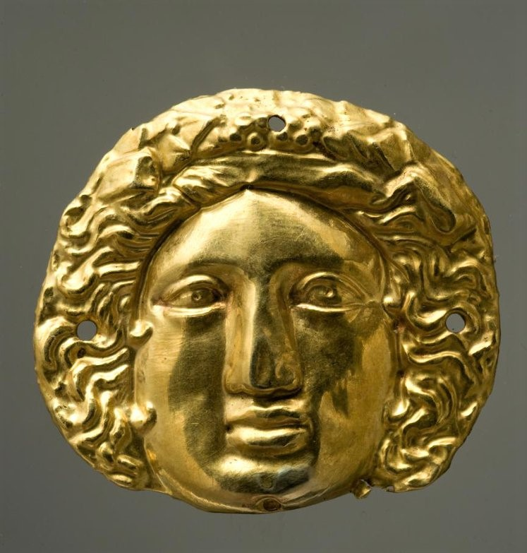 Бляшка с изображением лица Диониса. около 350 г. до н.э.