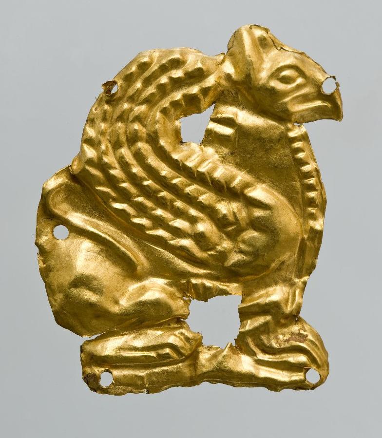 Бляшка нашивная: сидящий грифон в профиль. Около 350 г. до н.э.