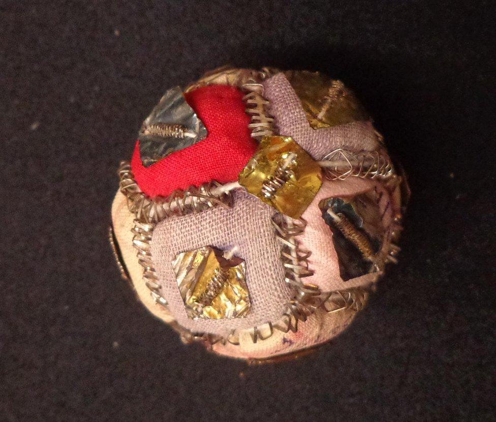 Погремушка-мячик. 1840-е гг. Материал, техника: шёлк, фольга.